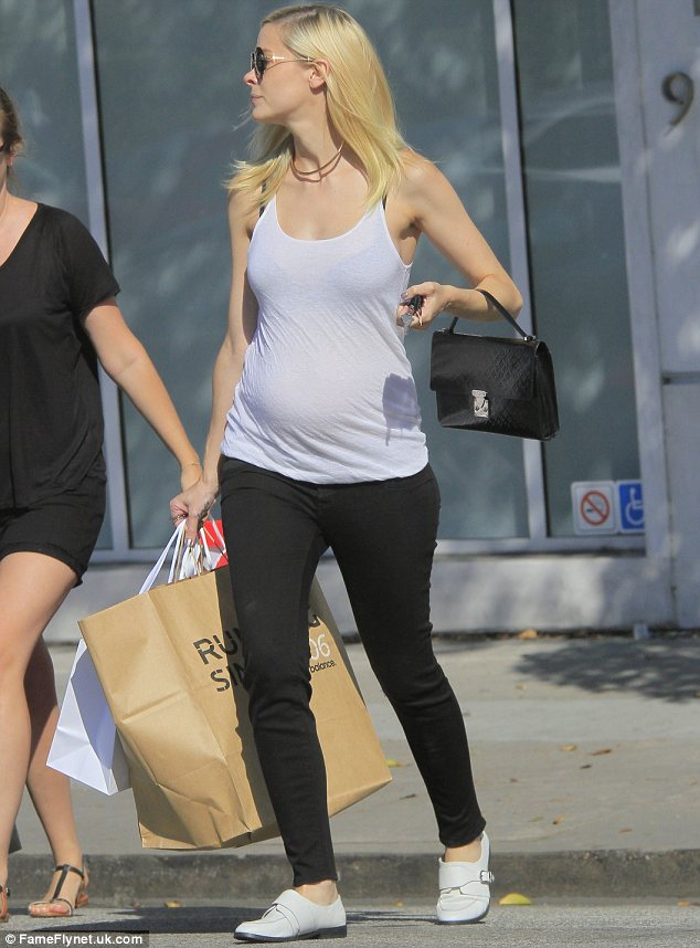 Keeping it casual: The 34-year-old stayed comfortable and also sported black jeans and simple white flats