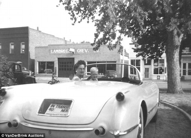 Family Business: Jeannie Lambrecht Stillwell with her son outside her parents Chevy dealership in Pierre, Nebraska in this undated photograph
