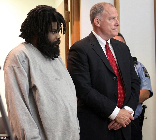Pleading Insanity: Tyree Smith, left, stands with public defender Joseph Bruckmann on the first day of his trial. Smith is charged with hacking to death a homeless man, Angel Gonzalez, and eating his eye and part of his brain