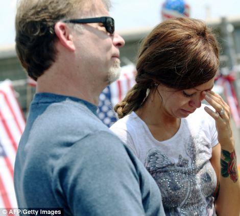 Heartbroken: Juliann Ashcraft, wife of fallen firefighter Andrew Ashcraft, cries alongside her father Tom Ashcraft outside of the Granite Mountain Hotshot fire station in Prescott