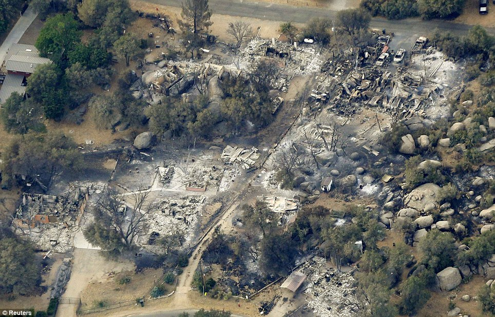 Homes: Scores of homes and buildings were burned to the ground in the inferno