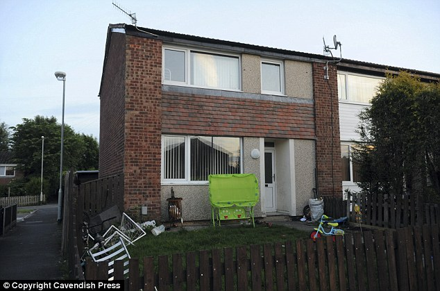 Crackdown: Police found the secret room during a raid on this semi-detached house in Oswaldtwistle, Lancashire
