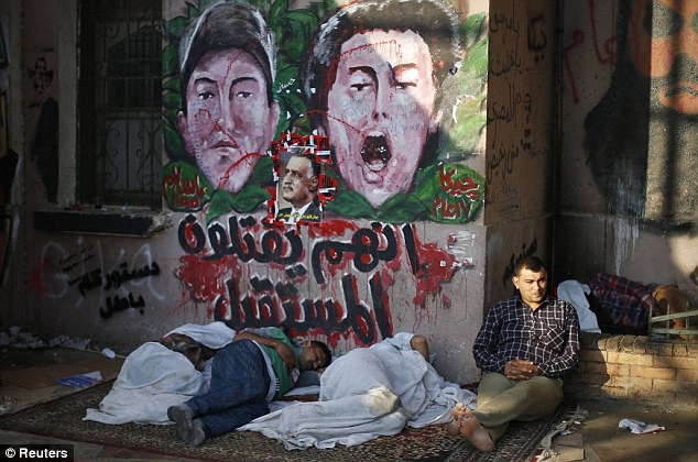 Dawn: Protesters opposing Egyptian President Mohamed Mursi sleep on the ground during a sit-in protest demanding that Morsi resign at Tahrir Square