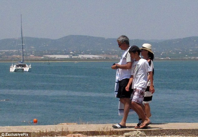 Taking time out: Mourinho spends time with his family on holiday
