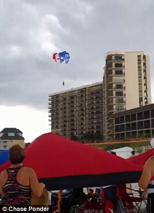 Horror: Beachgoers stare in disbelief as Alexis Fairchild and Sidney Good approach the apartment complex in Panama City Beach, Florida