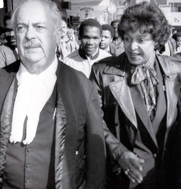 Old confidant: George Bizos, pictured here with Winnie Mandela in 1991, was Nelson Mandela's lawyer for more than half a century. He said Mandela's mental sharpness is greatly diminished