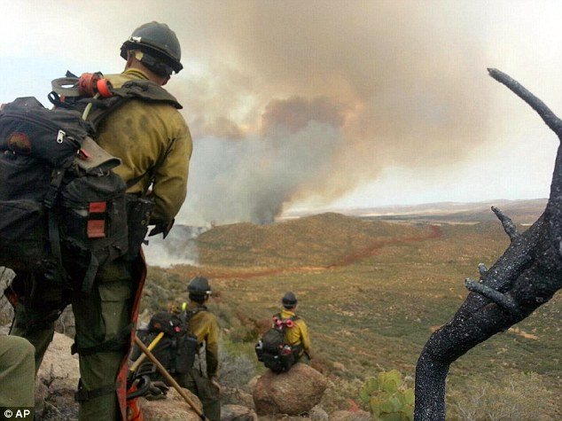 Last photo: Firefighter Andrew Ashcraft sent this photo of  members of the Granite Mountain Hotshots to his wife on Sunday, June 30, 2013, just before he and his colleagues were killed
