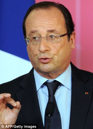 France's President Francois Hollande and his government have called for trade talks between the EU and U.S. to be postponed