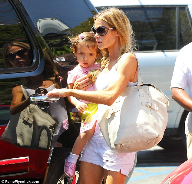 The perfect ex: Denise Richards with adopted daughter Eloise during a day out in California with Max and Bob last month