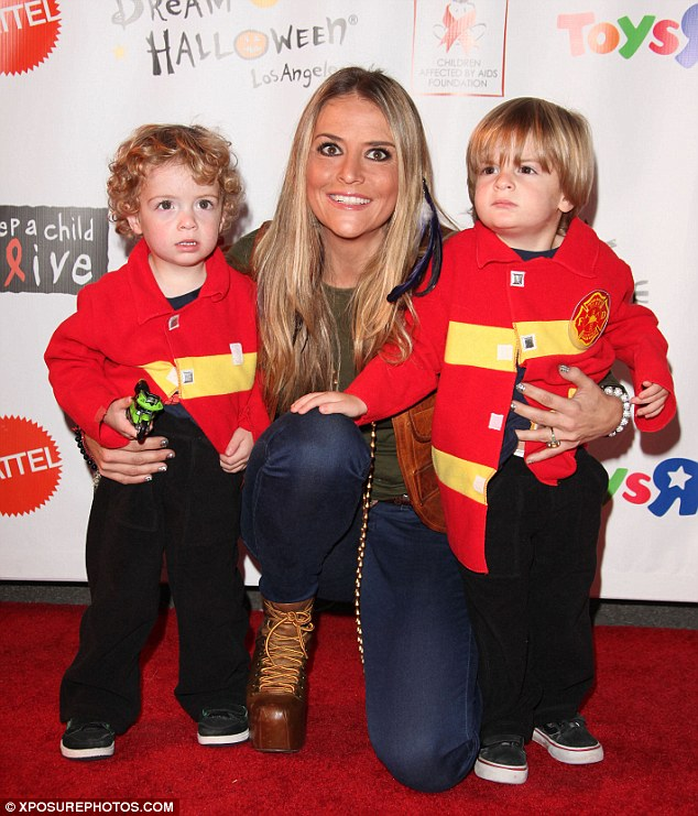 Troubled: Brooke Mueller poses for a shot with her two boys in 2011