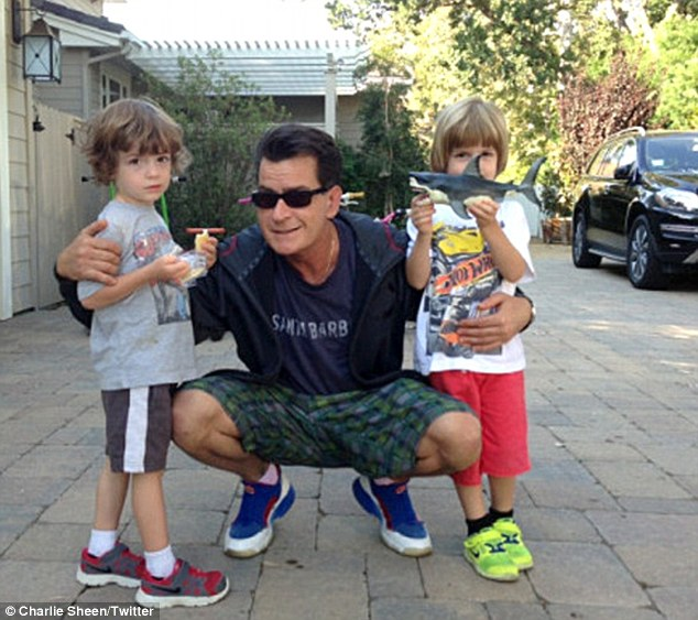 Happy families: Charlie Sheen poses for a loving snapshot with his two sons Max and Bob