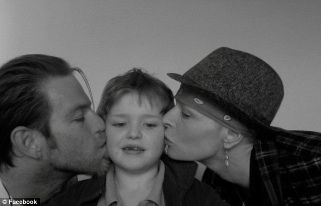Touching: The siblings posed with Charlotte's young son Lucas (center), eight, covering the child with kisses