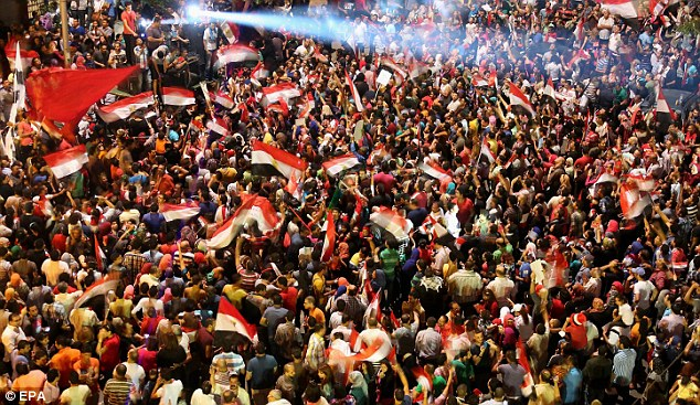 Turmoil: Political uncertainty in Egypt, where thousands of opponents of President Morsi flooded the streets of Cairo yesterday, is being blamed for bringing the recent recovery in the FTSE 100 to an end