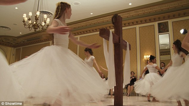 Sacred daughters: Fathers who attend the ball promise to protect their young daughters' 'purity of mind, body, and soul'