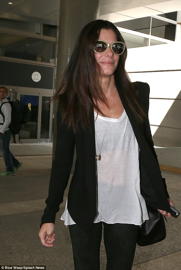 On the move: Sandra raced quickly to meet her son Louis