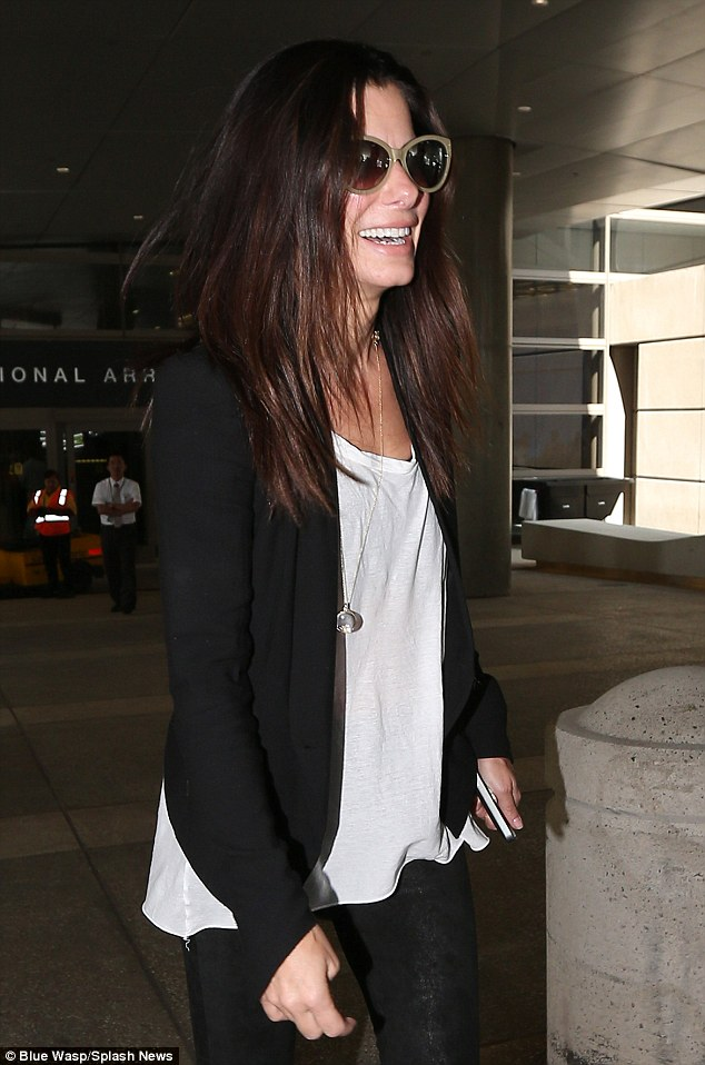 So happy! Sandra Bullock could not hide her joy after she met-up with her son Louis Bardo at LAX airport on Wednesday