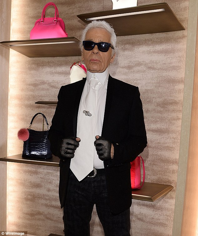 Busy man: The exhibition was held to show fashion icon Karl Lagerfeld's photographs. Earlier in the day, the designer also helped Fendi open its newest boutique