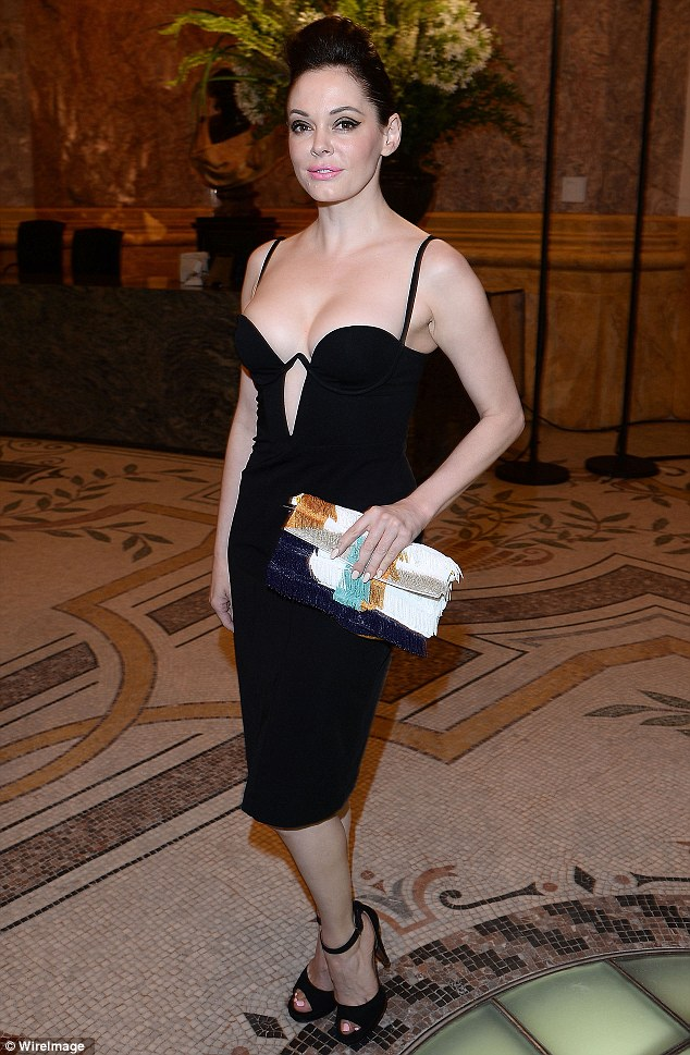 Revealing almost all: Rose McGowan showed off plenty of skin at The Glory Of Water exhibition in Paris, France, on Wednesday evening