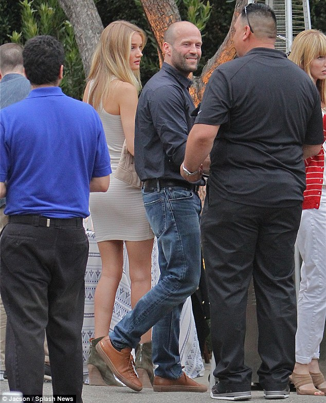 Party in the USA! British couple Rosie Huntington-Whiteley and boyfriend Jason Statham arrive to a house party in Malibu on the eve of July 4, Independence Day