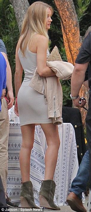 Transatlantic fashion battle: Paris wore a summery turquoise dress while Rose donned a form-fitting beige dress