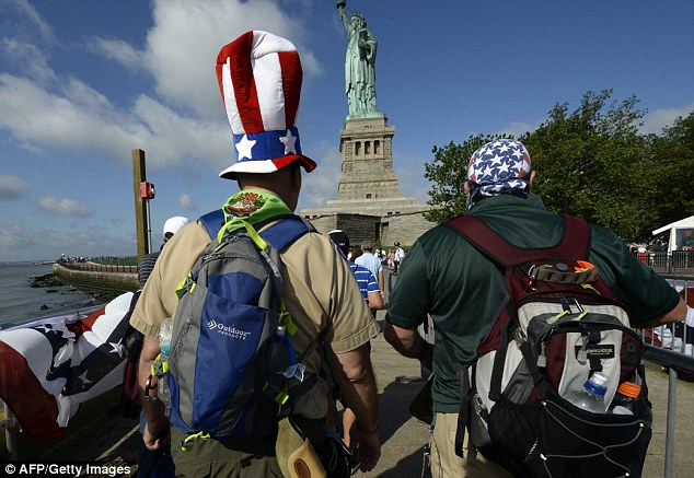 Tourists arrived on droves on Thursday to visit the Statue of Liberty after months of repairs restored Liberty Island to its former glory