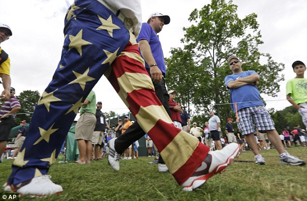 Patriot: John Daly walks with Peter Hanson (right) during the first round of the Greenbrier Classic