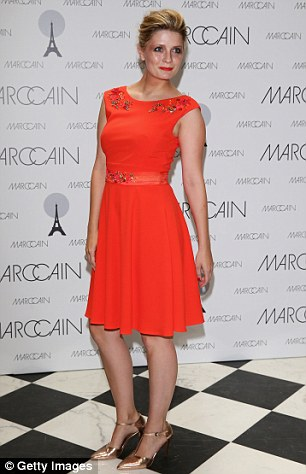 Glamour: Mischa styled her hair into a retro up-do and wore a bright red frock