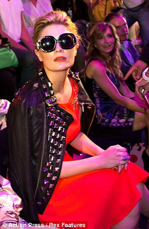Accessorising: Mischa changed her all-red look by adding a black jacket and sunglasses