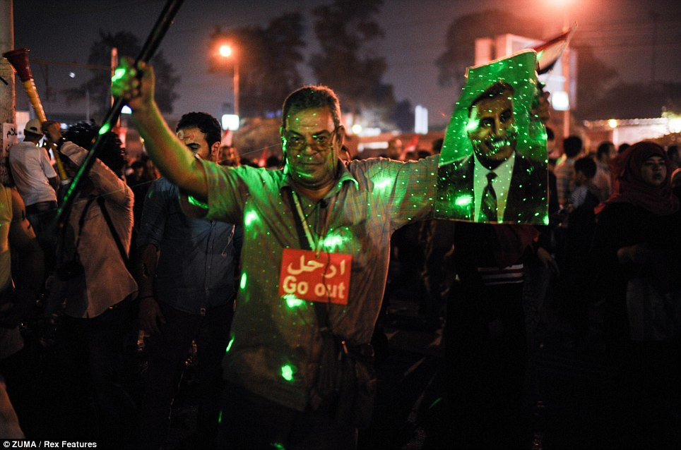 Overjoyed: Millions of anti-Morsi protesters around the country erupted in celebrations after the televised announcement by the army chief on Wednesday evening