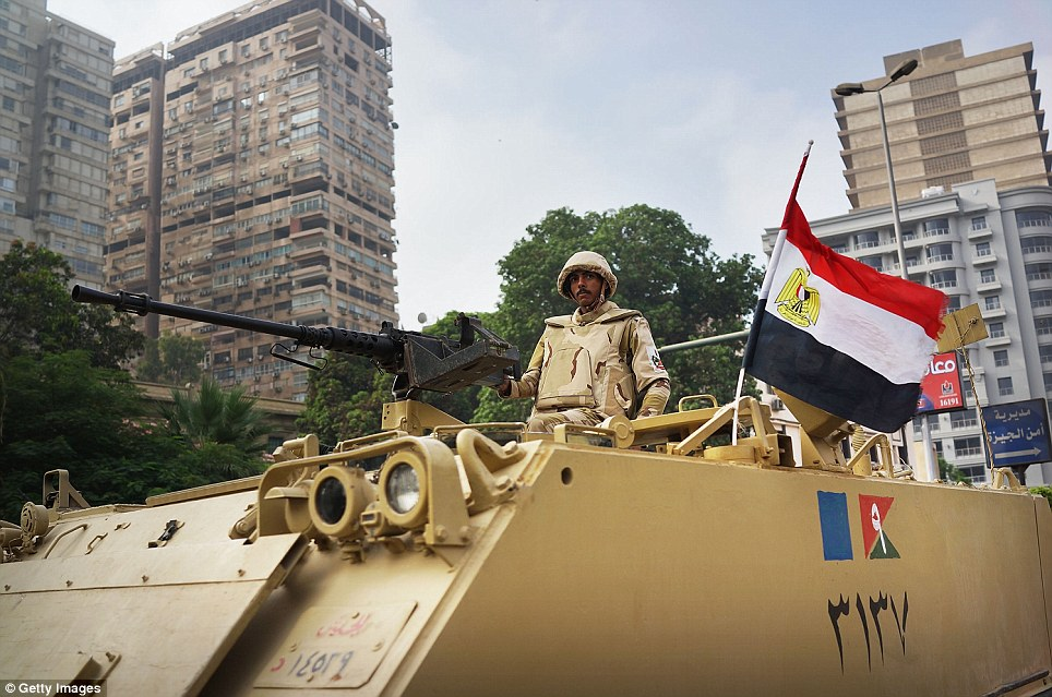 On alert: Troops and armoured vehicles were deployed in the streets of Cairo and elsewhere to surround Islamist rallies over fears of a violent reaction to the coup