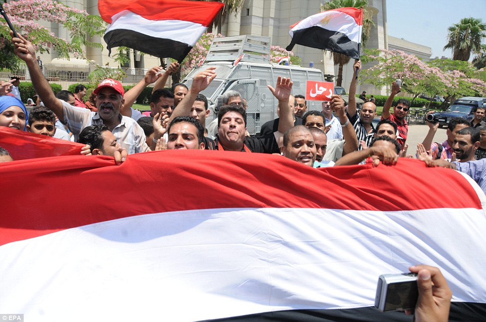 Fervour: Opponents of ousted President Morsi gather outside the Supreme Constitutional Court where Adly Mansour, the chief of Egypt's highest court, was sworn in as interim president