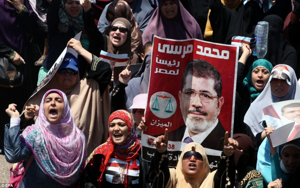 Standing by their man: Supporters of ousted president Mohamed Morsi protest in Cairo