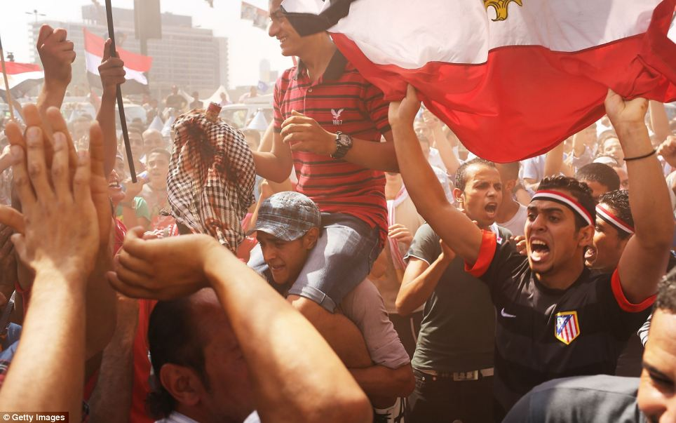 As protestors cheered the news, Adly Mansour, chief justice of the Supreme Constitutional Court, was sworn in as the interim head of state the day after Morsi was placed under house arrest by the Egyptian military and the Constitution was suspended.