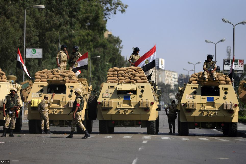 Gathering: Egyptian soldiers secure the area around Nasser City, where Muslim Brotherhood supporters have gathered to support ousted president Mohammed Morsi, in Cairo