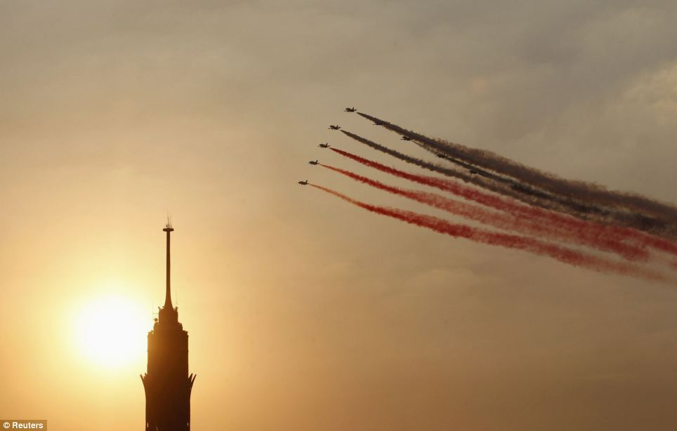 Celebration: Egyptian military jets fly in formation over Cairo as the head of Egypt's constitution court Adli Mansour is sworn in as the interim head of state