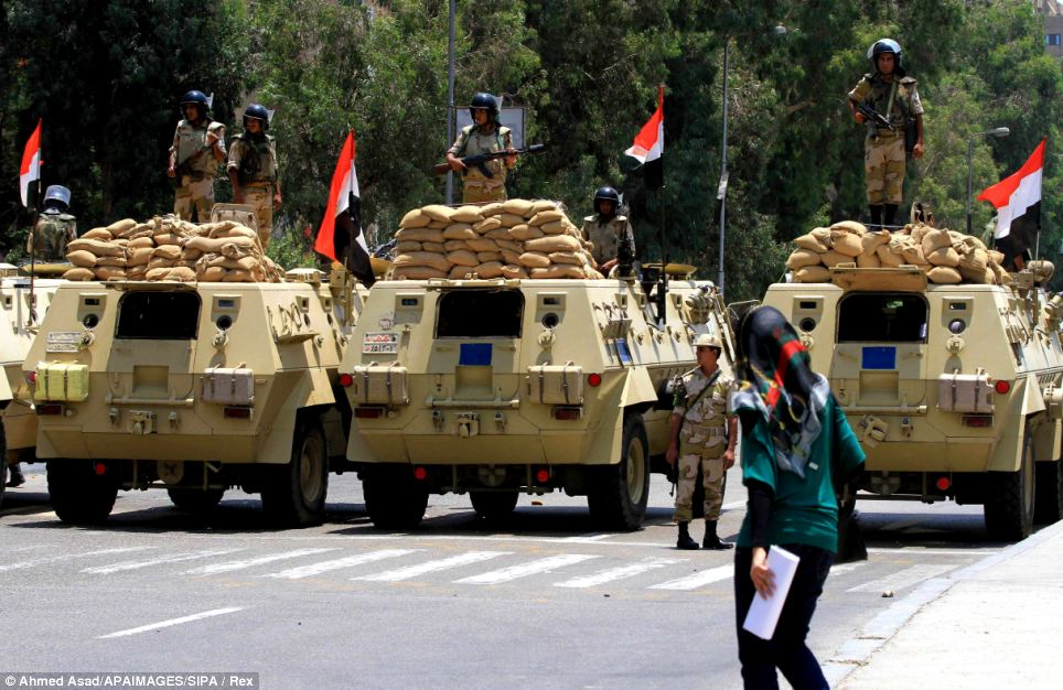 Presence: The Egyptian Army line up across the road near the Presidential Palace, one day after the ousting of President Mohamed Morsi