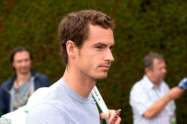 The morning after: Andy Murray arrives at Wimbledon to practice on Thursday