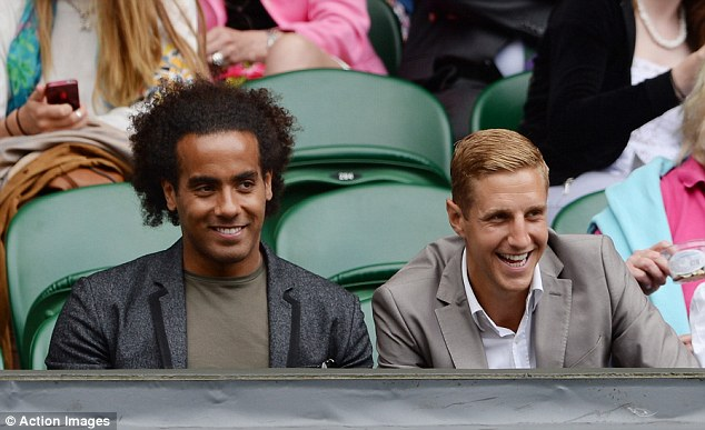 From Spurs to Wimbledon: Tottenham stars Tom Huddlestone (left) and Michael Dawson look on at SW19