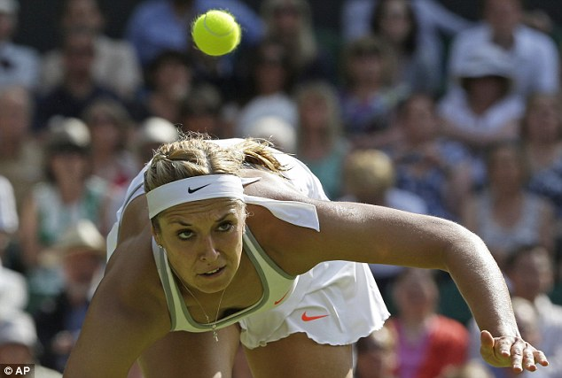 Off balance: Sabine Lisicki attempts to chase down a Radwanska return