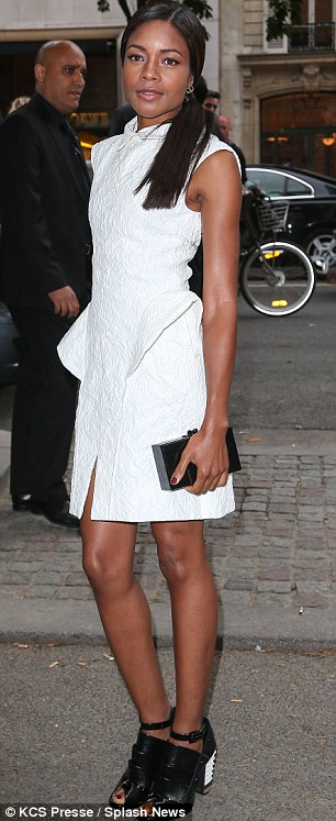 A contrast in styles: While Naomie Harris wore an elegant white dress Tallulah Willis wore unsightly trousers