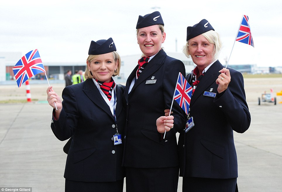 Good day for BA: Tricia Dowdell, 50 From Ascot, left, Sarah Kiff, 47 from Croxley Green, centre, and Julie Coker, 47 from Hayes, right, await the new arrival at Heathrow