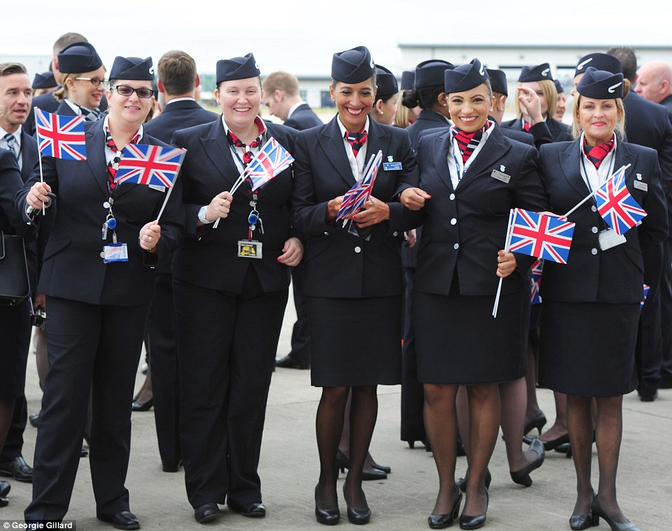 Welcome party: From left to right, Graziella Buttaci, 26 from Surrey, Ruth Forbes, 29 from Beaconsfield, Delilah Legdlai, 40 from London Esha Sakon, 39 from Sandhurst and Laura Keeping, 40 from St Albans wve their flags to welcome the plane