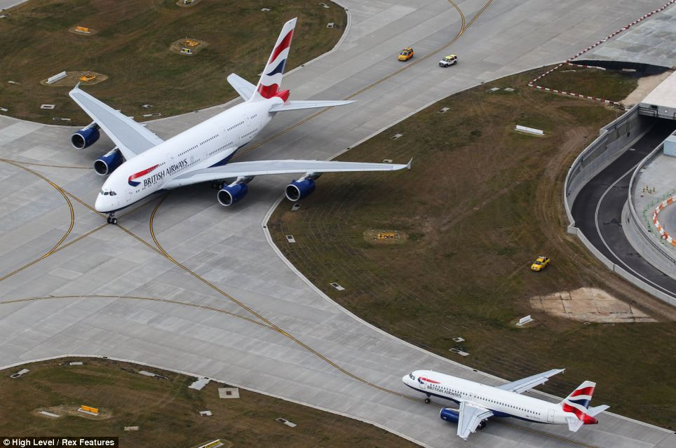 Giant: British Airways' first Airbus A380 superjumbo next to a sister Airbus A320 having arrived on its delivery flight