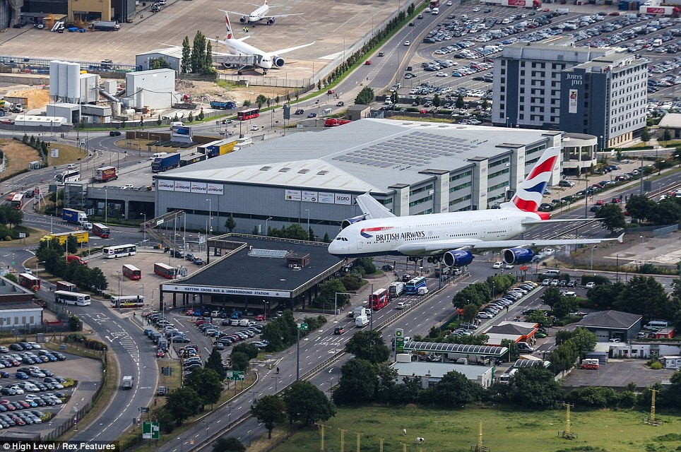 Arrival: The British Airways Airbus A380 prepares to touchdown at Heathrow this morning for the first time