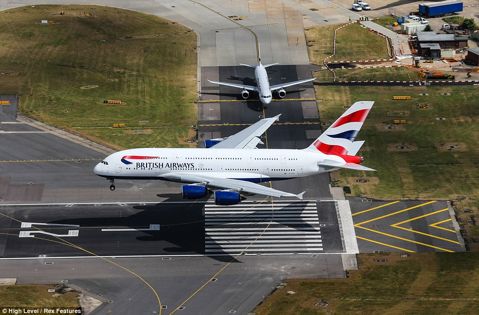 Touchdown: The £270million A380 lands at Heathrow for the first time as the airline takes delivery of its first of 12 new planes