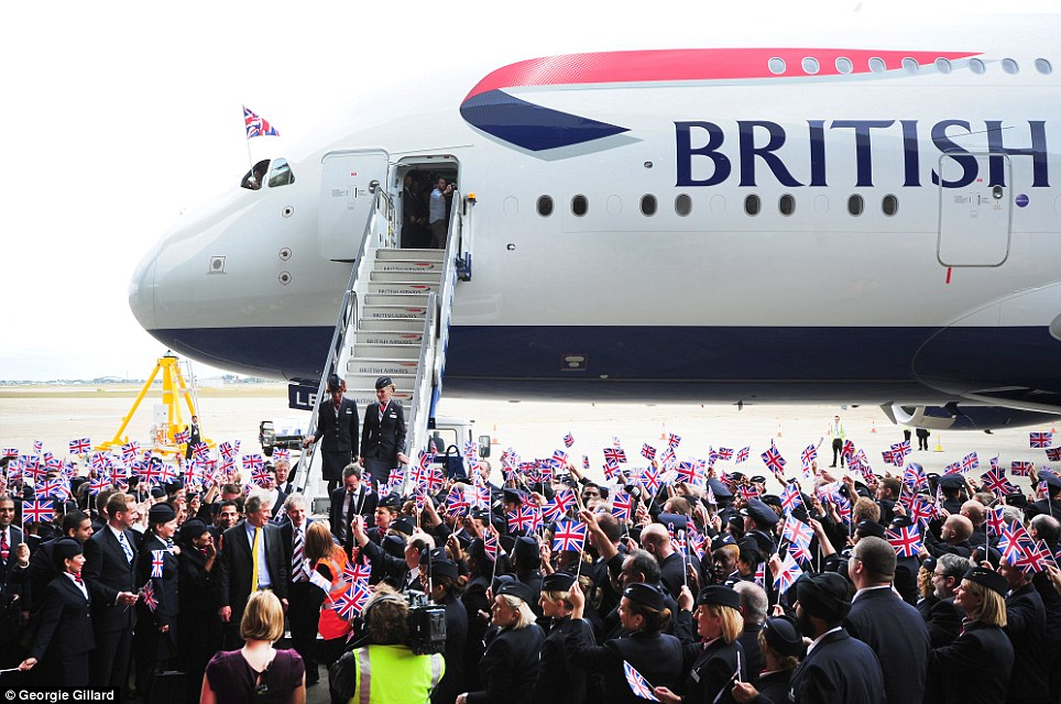 Arrival: BA staff celebrate outside at Heathrow as the A380 parks up for the first time outside its airbase