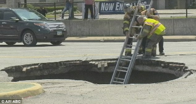 Escape route: A ladder was carefully lowered into the hole which was estimated to be 10ft deep