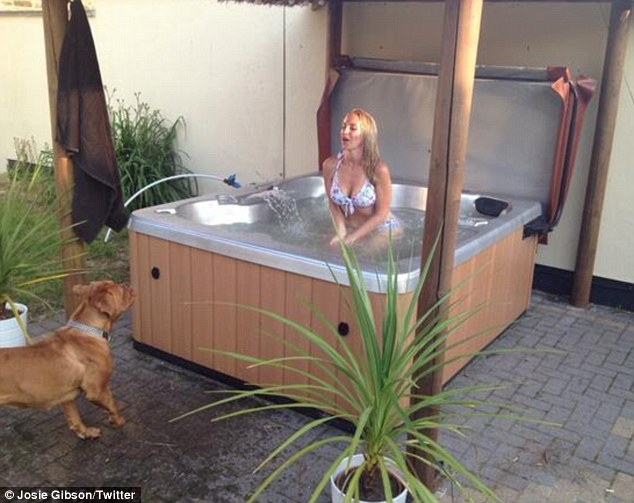 Room for two? Josie's canine companion seems unsure about the luxury tub