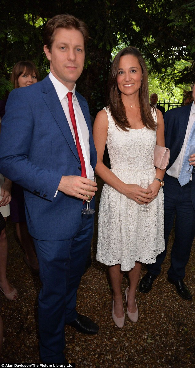 Contributor: Pippa Middleton attended The Spectator magazine summer party, of which she is a contributor. Pictured here with Fraser Nelson, editor of The Spectator