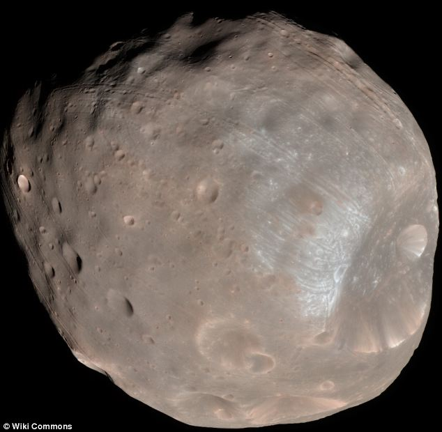 Phobos, the moon seen in the video and pictured here, measures just 14 miles wide